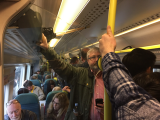 Uckfield LibDem District Council Candidate Tim Murray keeps his cool on a crowded train to London