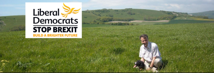 Wealden LibDem PPC Chris Bowers with his dog Pedra on the South Downs