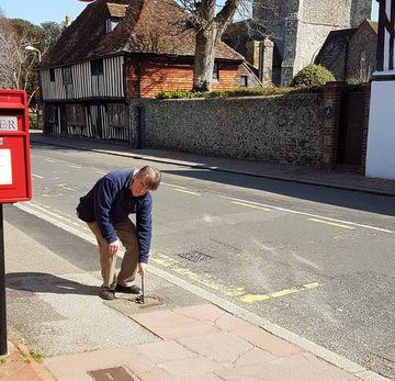 Mark Fairweather inspecting potholes in Westham